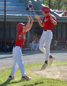 Bismarck (N.D.) is all smiles against Atlantic Shore (N.J.) in a Babe Ruth Baseball 14-Year-Old World Series semifinal Wednesday at Bullens Field. (Photo by Marc St. Onge)