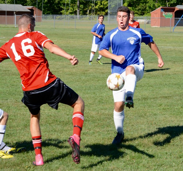 Gateway (blue jerseys) battled Hampshire Regional (red) Monday in the first of three scrimmages scheduled for the Gators' boys' soccer team this week. (Photo by Chris Putz)