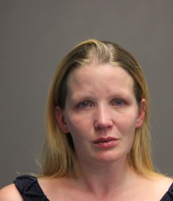 Woman arrested and charged with drug possession