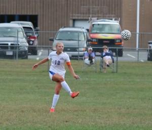 Gators' forward Jessica van Heynigen (12) kicks the ball, looking to connect with an open teammate. (Photo by Kellie Adam)