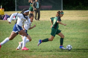 St. Mary's Allie Goudreau outruns Putnam defenders on her way to a game-tying goal Monday at Hubbard Park. (Photo by Marc St. Onge)