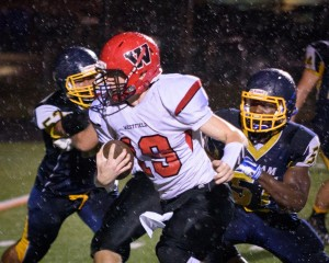 Westfield senior quarterback Austin St.Pierre powers through the Putnam defensive line Friday night at Central High School's Berte Field. (Photo by Marc St. Onge)