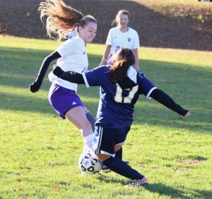 Westfield Technical Academy's Heather Lannon (11) battles hard over Putnam to gain control of the ball Wednesday at Jachym Field. (Photo by Kellie Adam)