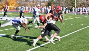 Westfield High School senior Zach Adam races toward the end zone for one of his two finals touchdowns Saturday against West Springfield. (Photo by Marc St. Onge)