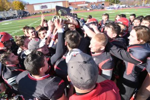 The Westfield Bombers celebrate a Division 2 West Sectional championship Saturday at Holyoke High School. (Photo by Marc St. Onge)
