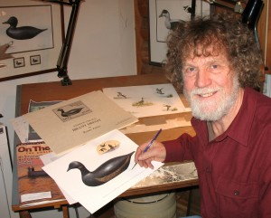 Randy Julius in his studio working on one of his Massachusetts waterfowl stamp designs. Julius is encouraging youth people to enter a writing contest, sponsored by the New England Outdoor Writers Association.