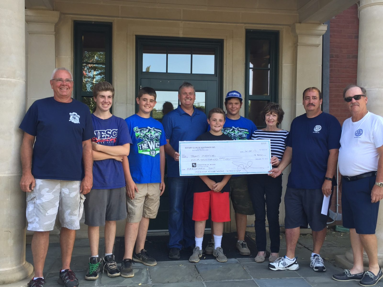 Rotary Club presents check to help fireworks
